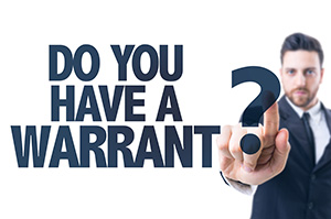 We can do warrant checks at EZ Out Bail Bonds